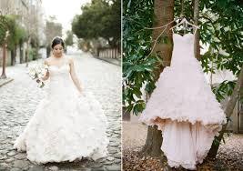 allure couture wedding dresses. classic bride wears allure couture wedding dress poses with groom dresses