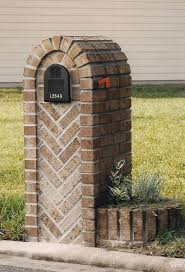 Brick Mailbox with Herringbone pattern and additional brick planter  attached. Lets seem them hit this