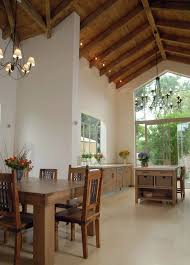 view in gallery subtle ceiling spotlights in a kitchen with high ceilings