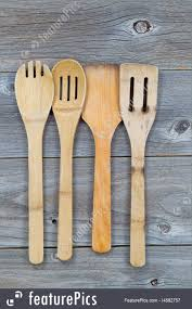 kitchen vertical image of old wooden cooking utensils on rustic wood