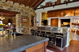 kitchen stone wall tiles. Farmhouse Style Kitchen With Stone Wall And La Cornue Range [Design: Squaresapace] Tiles