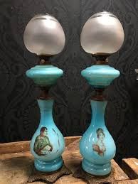 set of two antique blue glass oil lamps with decoration of napoleon and josephine late