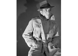 humphrey bogart in a trench coat and fedora 1940s corbis