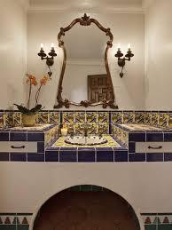 Bathroom - mediterranean multicolored tile and ceramic tile terra-cotta  floor bathroom idea in Santa