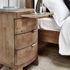 Winchester Rustic Bedside Table next to rustic bed