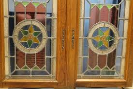 pair of stained glass panels previously used as cabinet doors late 19th century