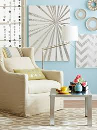 diy wall canvas ideas. diy: cut metal repair tape and adhere in geometric patterns to the canvases. silver material stands out against blue walls. diy wall canvas ideas
