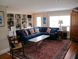 i love this blue sofa with the red persian rug living room done from classic and oriental eastern living room sofa source com