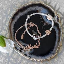 wearing soufeel name bracelet in rose gold and rose gold clasp bracelet with charms