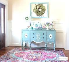 bold area rugs traditional foyer with an aqua blue painted buffet on a pink and rug the classic contrast of black white bold area rugs