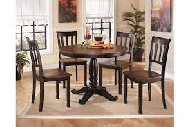 charrell 5 piece round dining dining room astounding ashley furniture round glass