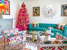 you can tastefully use bold colors that plement the living room s color palette here a bright pink tree is balanced with a teal sofa and graphic prints