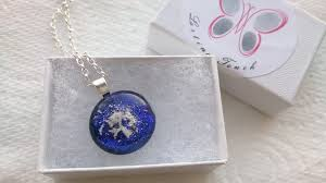 making a glass necklace with cremation