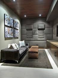 metropolitan theater austin with contemporary home theater and area rug artwork built in media cabinet gray gray sofa leather ottomans padded walls pillows