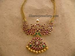 gold necklace with ruby pendant 48 gms
