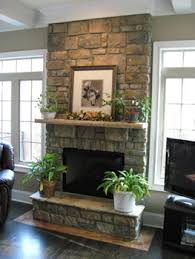 appealing mni black wood burning fireplace by fireplace candelabra plus decorative  stone wall and wooden shelf