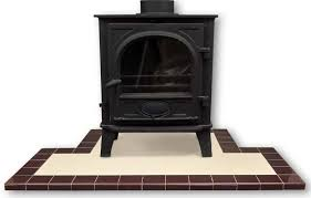 fireplace hearths in square plain glazed tiles