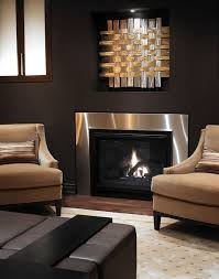 now there s a classy use of brown tones regina sturrock design interesting artwork over fireplace