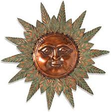 metal sun face wall hanging with rustic