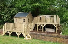 wooden garden playhouse with platforms