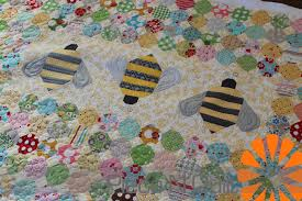 Piece N Quilt: Calico Hive Quilt & The bees are adorable, so I machine quilted some fun details on them to  really make them pop! Adamdwight.com