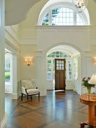 two story foyer entry traditional with white column double front doors