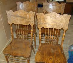 4 press back oak chairs