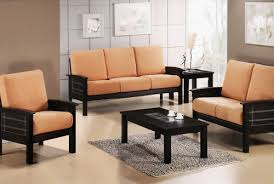 black wooden sofa set with peach fabric of seats Decor Craze