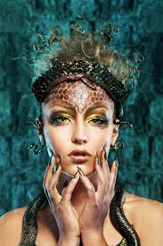 gorgon medusa in dungeon young woman with creative fantasy hairstyle and make up