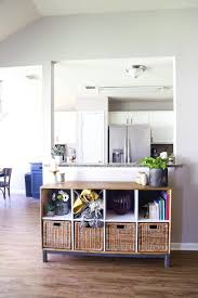 image looking into a kitchen with a wood credenza sitting under the bar
