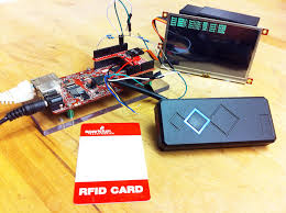 reading 125 khz rfid cards using wiegand protocol in python rfid reader and lcd plugged into the rascal