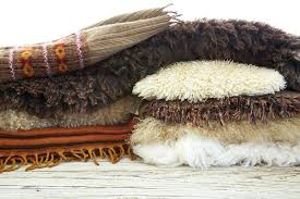 types of rugs materials still life wool blankets pillows and pelt on wood table types of rugs materials