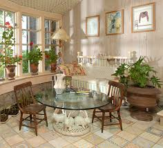 sunroom decor. Nice Vintage Country Sunroom Decor With Glass Top Round Coffee Table And Varnished Timber