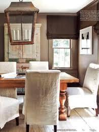 dining room with linen slipcovers oversized lantern dark walls ben moore satchel by westbrook interiors