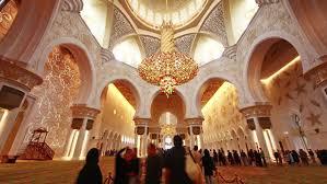 4k00 04abu dhabi uae july 2016 famous main mosque crowded inside 4k time lapse circa july 2016 abu dhabi united arab emirates