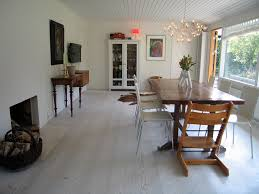 white washed wood floor. Luxurious Dining Room Design With Large Glass Window And Rectangle Wooden Table Chairs White Washed Wood Floor