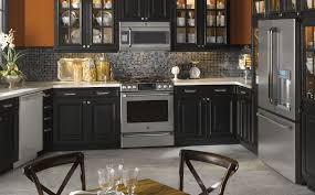 Kitchens With Black Appliances White Kitchen With Black Appliances Flowers In Pot As Cent Natural
