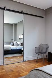 Mirror as sliding barn door Mirror ideas for every room in the home.  Photographer: Jody Kivort Designer Cristiana Mascarenhas of InPlus Inc  Design.