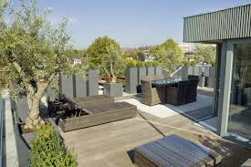 Exterior:Delighful Roof Terrace Design With Relaxing Grey Wicker Lounge  Chair And Wooden Floor Idea