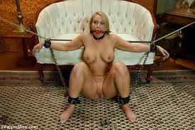 Hot blonde in lesbian dildo bondage