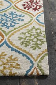 terra collection hand tufted area rug in cream blue green red design by chandra rugs red green yellow navy blue and turquoise