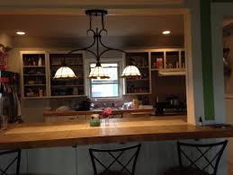 there are any other good options though because recessed lighting would be too hard and if we just took it out wed have holes thatd be hard to patch breakfast bar lighting