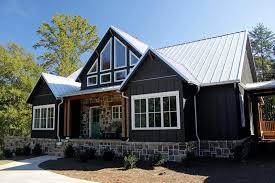 rustic mountain house plan dark shake stone porch