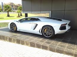 lamborghini aventador white back. taking your foot off the loud pedal at low speed makes this deep v12 grumble which will without a doubt get hair on back of neck to stand up lamborghini aventador white