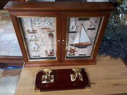 large key cabinet with 2 dioramas and a maritime coat rack