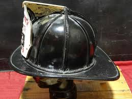 this is a cairns leather fire helmet with san francisco leather front marked engine 13 sffd