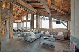 ski chalet furniture. Here, Above, Modern Furnishings And Lighting Are Set Amongst Rustic Beams Wood Clad Walls. This Great Room Is Sparse But Welcoming. Ski Chalet Furniture