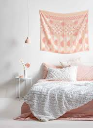 to make your own wall hanging simply a large scarf or sarong or pick up a piece of material that catches your eye at your local fabric
