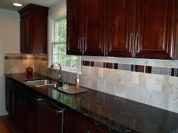 tile under kitchen cabinets recessed and under cabinet lights provide task lighting on the counter areas tile under kitchen cabinets