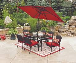 red patio umbrella with dining set and area rug for patio decoration ideas